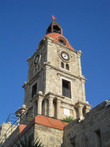 The clock tower of the medieval town of Rhodes, part of city tour