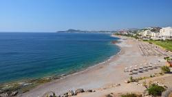 Faliraki beach , long sandy , busy , full of life.